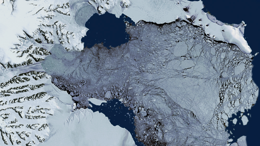 Still of the Larsen-B ice shelf collapse on December 8, 2002, as shown by Landsat-7.