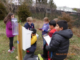 Students working with Rain gauges