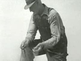 Farmer holding dry soil