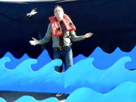 """Thumbnail for """"For Good Measure"""" showing Ryan in front of makeshift waves."""