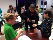 Students building rain gauges
