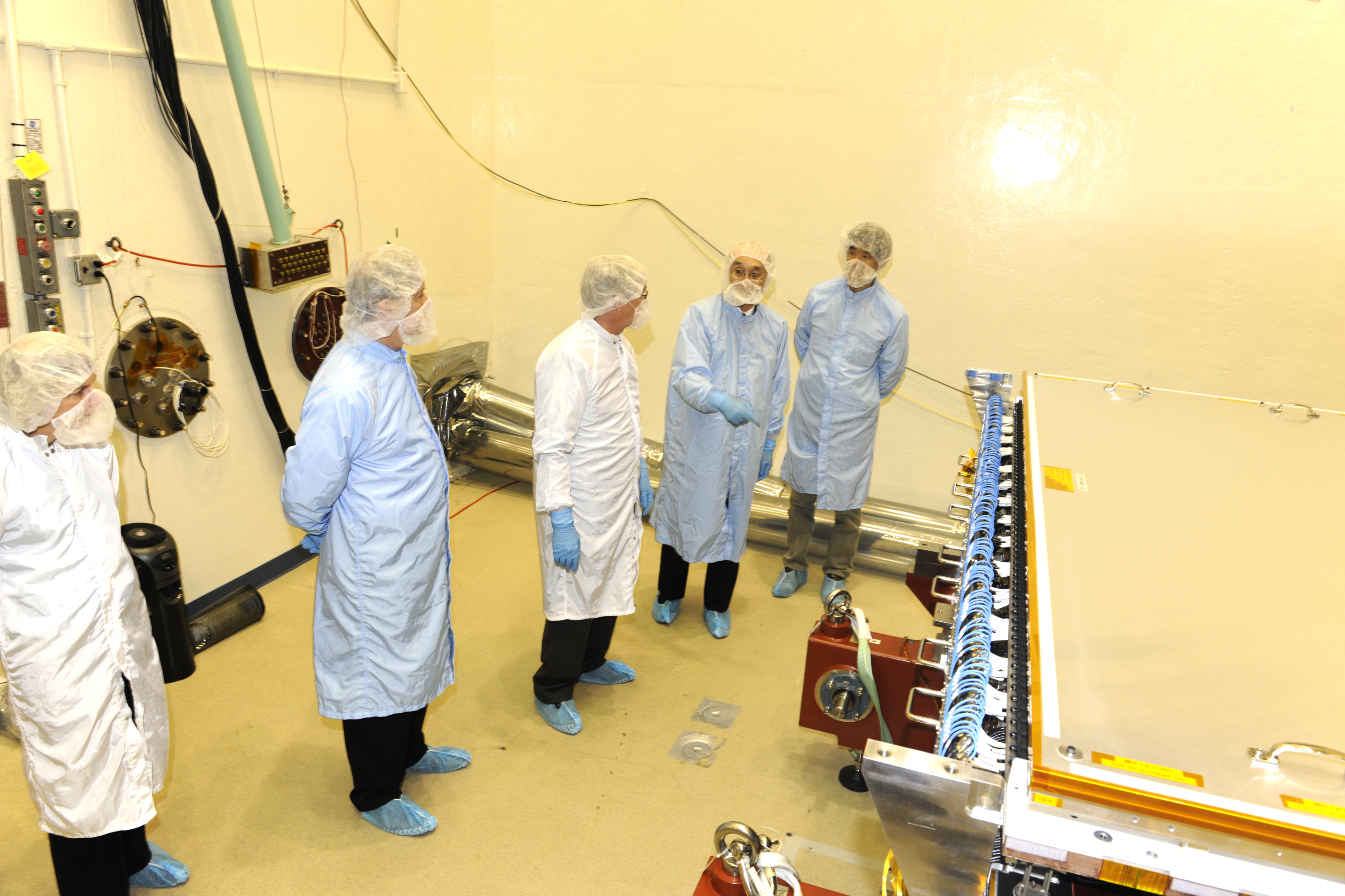 NASA and JAXA scientists in front of the DPR