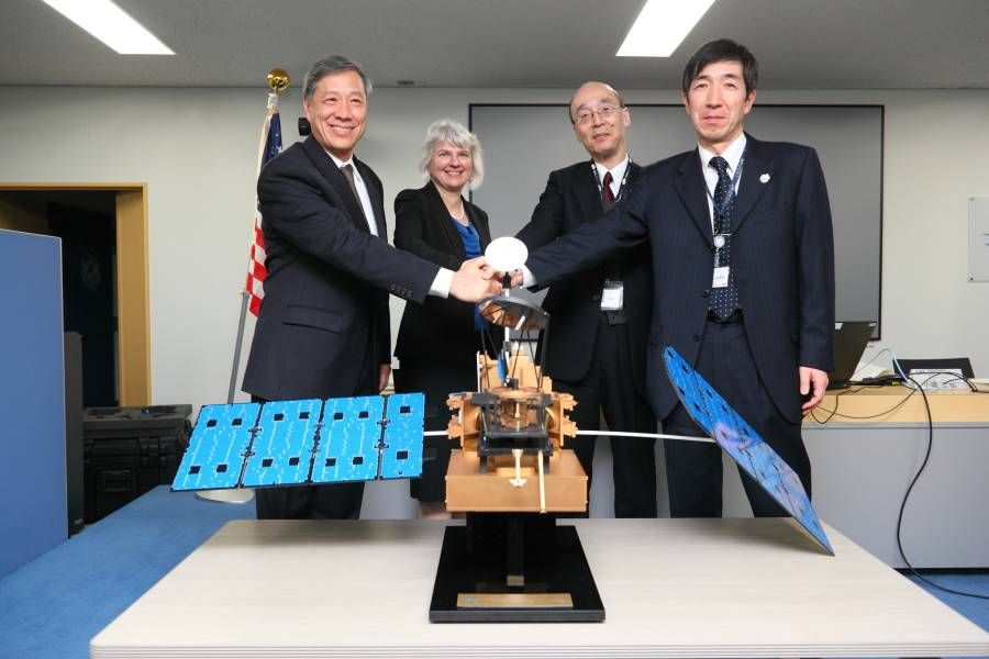 GPM Leads at the JAXA DPR Press Release, standing behind a model of the GPM Core