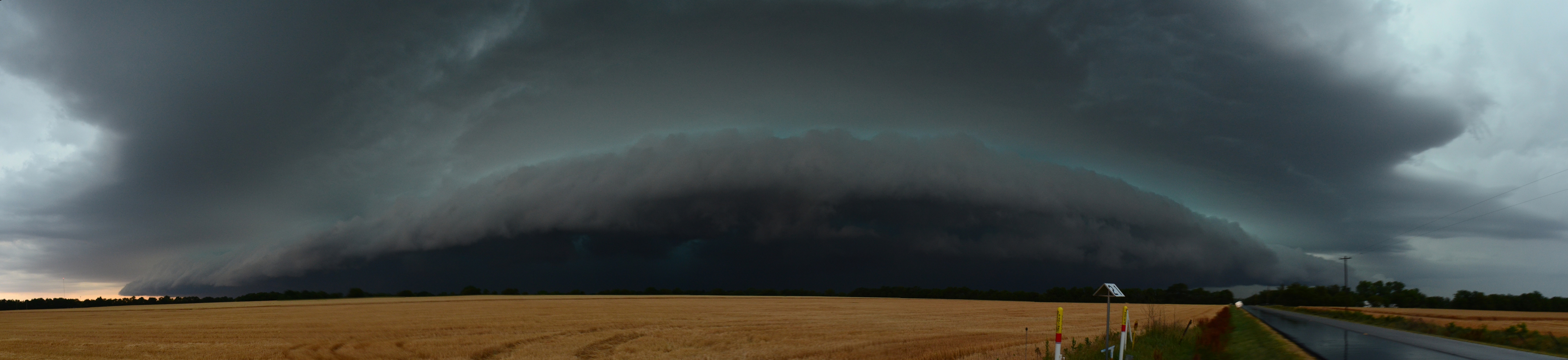 Huge panoramic view of an approaching storm.