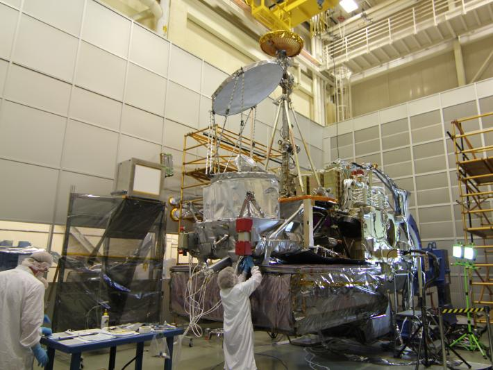 Engineers check on the GPM spacecraft after successful completion of its first comprehensive performance test at NASA Goddard Space Flight Center.