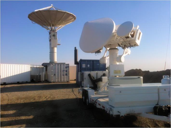 The NASA NPOL (right) and D3R (left) precipitation radars deployed south of Waterloo, Iowa, for the Iowa Flood Studies ground measurement campaign.