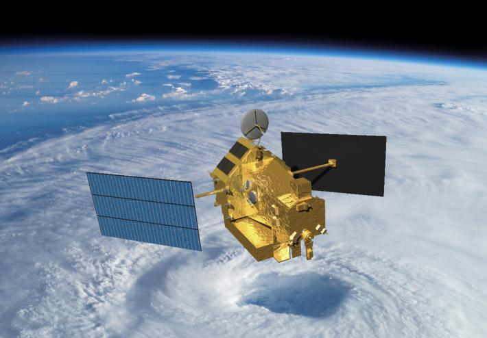 Artist concept of TRMM in space over the eye of a tropical cyclone.