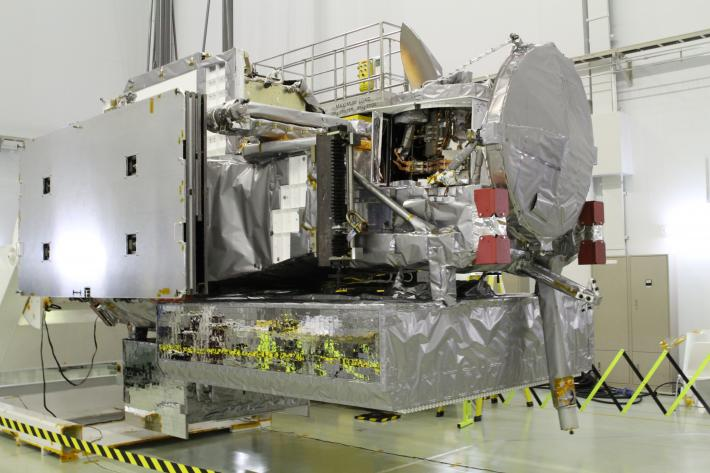 The GPM spacecraft oriented for inspections after its arrival in the clean room at Tanegashima Space Center.
