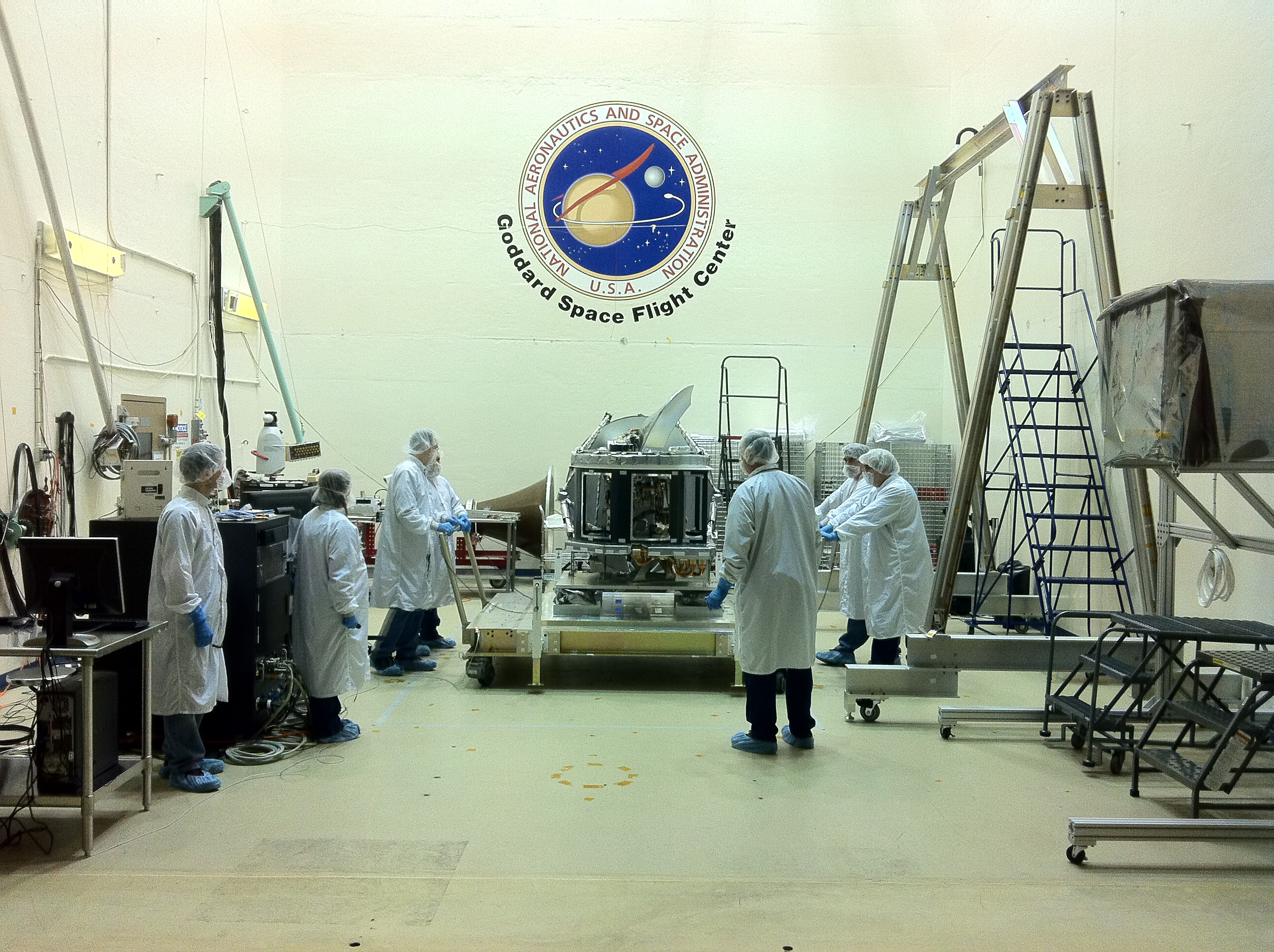 the GMI at Goddard, surrounded by engineers