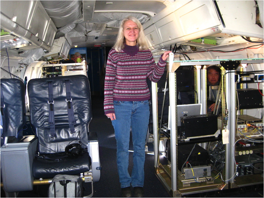 Scientist Gail Skofronick-Jackson standing in the DC-8 aircraft