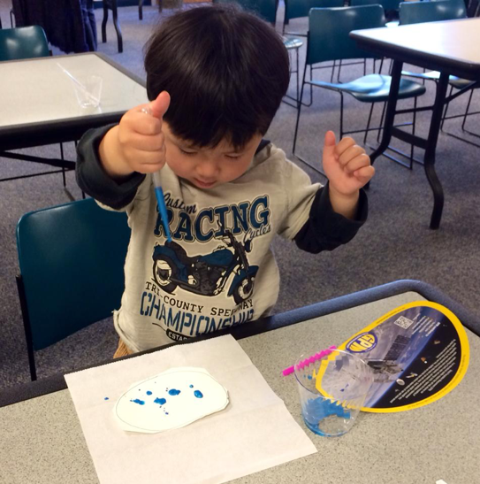 Preschool kid playing with GPM droplet