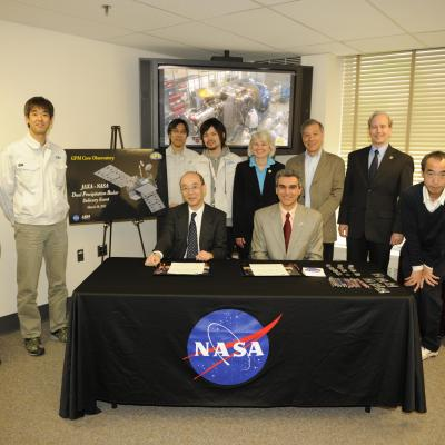 NASA and JAXA officials at the DPR signing event