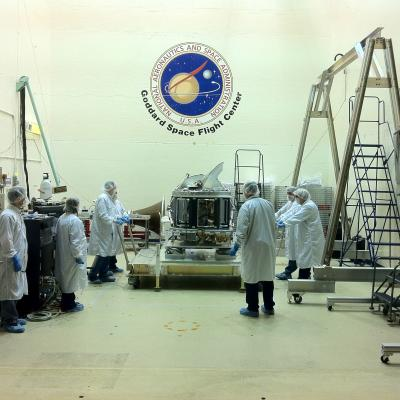 Scientists stand around the GMI which just arrived at NASA Goddard